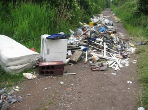 Fly-tipped rubbish on the road
